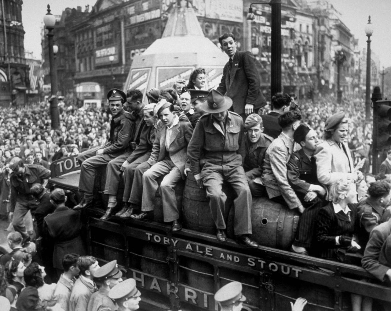 8th May 1945: A van load of beer passing through Piccadilly Circus on VE Day. The statue of Eros, protected during the war by advertising hoardings, can be seen in the background. (Photo by Keystone/Getty Images)