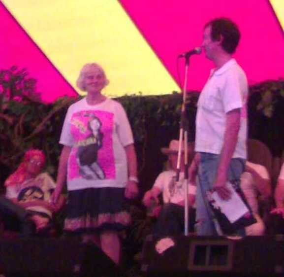 The crowd went wild and jogged the photographer's elbow: onstage in this blurry shot with Viva in Jamie Reid's Sex Pistols Fuck Forever t-shirt, Port Eliot Lit Fest, 2006/