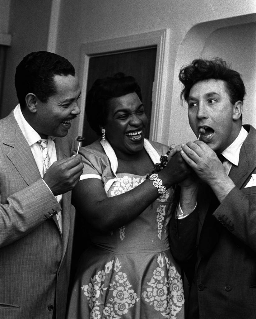 England, 1954, British musician Winifred Atwell is pictured with American singer and musician Billy Eckstein (left) and actor and comedian Frankie Howerd at a party (Photo by Popperfoto/Getty Images)