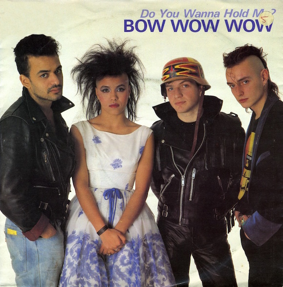 Front cover of 1983 Bow Wow Wow single released after McLaren quit managing the group. Design on helmet worn by bass-player Leigh Gorman (second right) combined the cross from the Fox design with the arrowheads from the Pawnee strap