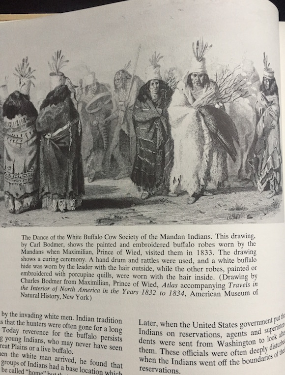 Morrow included this depiction of the Dance Of The White Buffalo Cow Society of the Mandan showing painted and embroidered buffalo robes