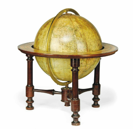 A 12-INCH TERRESTRIAL GLOBE George Philip & Son, early 20th century Philips' 12 inch library globe twelve chromolithographed gores and two polar calotes, held in an plain brass meridian with two hour rings, engraved and hand-coloured horizon ring, supported on three turned legs united with cross-stretchers. 18½in. (47cm.) high