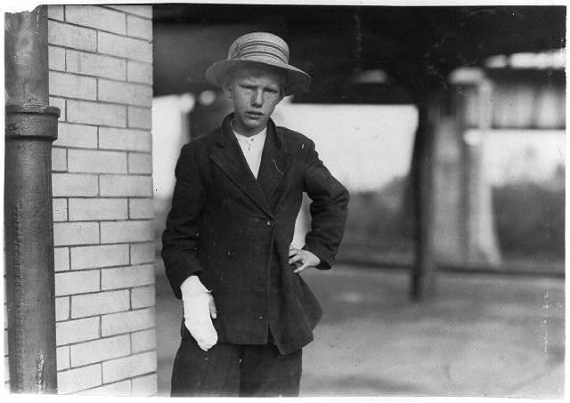"""An accident case of a 13-year-old doffer. Had been working since he was nine. """"I got my hand caught in the cogs of the spinning machine, and lost part of my finger. It stopped the machine and I tell you it hurt. It pains me a lot now. Don't you think they orter pay me wages while I'm out with this bad hand? No, I can't read or write, but I think my mammy knows how to spell my name."""" Location: Weldon, North Carolina. Lewis Hines"""