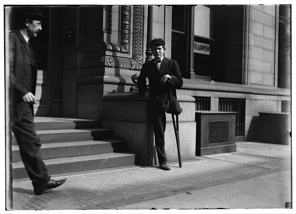"""National Child Labor Committee No. 954. 1-legged boy. Neil Gallagher, Wilkes Barre, Pa. Born January 14, 1891. Went to work at about 9 years. Worked about two years in breaker. Went inside at about 11 years. """"Tripper,"""" tending door. 83 cents [a] day. Injured May 2, 1904. Leg crushed between cars. Amputated at Mercy Hospital, Wilkes Barre. """"Baltimore Tunnell"""" - """"Black Diamond"""" D. & H. Co. Thomas Lewellin Superintendent (inside boys); Samuel Morgan, Superintendent. In Hospital 9 weeks. Amputated twice. No charge. Received nothing from company. """"Was riding between cars and we aren't supposed to ride between them."""" No written rules, but they tell you not to. Mule driver (who was on for first day) had taken his lamp and he tried to reach across car to get it. Slipped between bumpers. Been working in breakers since. Same place $1.10 a day. Work only about 1/2 time. Work about 6 hour day. Left 3 months ago. Been in N.Y. - no work. Trying to get work in Poolroom. Applicant at Bureau for Handicapped, 105 E. 22nd Street, N.Y. Nov. 1, 1909. Father living, (Mother dead.) Miner same place. Hurt month ago Rock fall. 2 brothers 25, 27. Home 15 Pennsylvania St. Location: Wilkes Barre, Pennsylvania."""