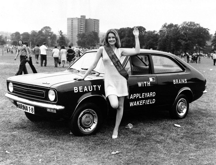 "Beauty with Brains"", Yorkshire Miners' Coal Queen 1973 waves to the camera at a Coal Board gala."