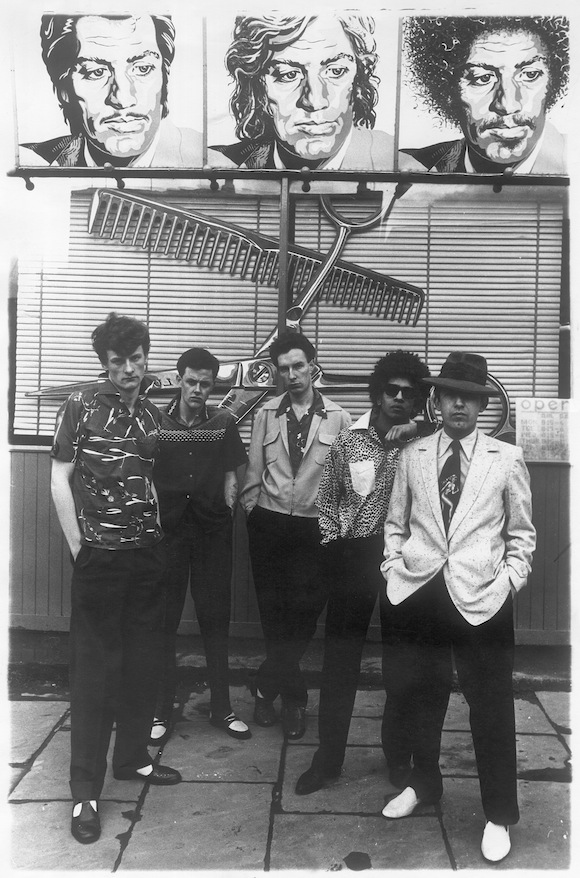 Original print of photo for Club International, 1975. Models include, from far right, Stephan Raynor, Don Letts and Martin Brading. Photo: David Parkinson