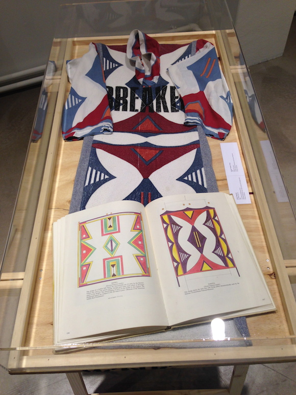 Savages Navajo print dress with McLaren's annotated copy of Indian Rawhide. Both private collection