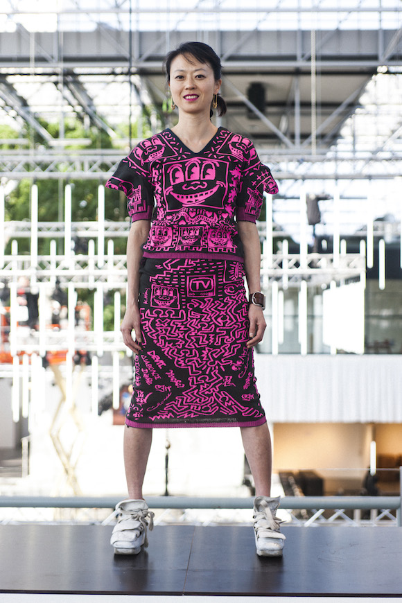 Young Kim in jacquard Keith Haring print Witches two piece and multi-tongued sneakers. All clothes from Kim Jones coillection. Photo: Jean Francois Carly (c) Malcolm McLaren estate