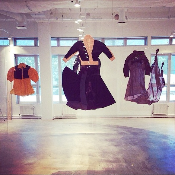 Outfits float in the air, from left: Pirate waistcoat and dress worn by Annabella Lwin of Bow Wow Wow in performance; Let It Rock shawl collared blouse and circle skirt; Nostalgia Of Mud wool toga dress with Folkways print. Malcolm McLaren Estate, Kim Jones Collection, private collection