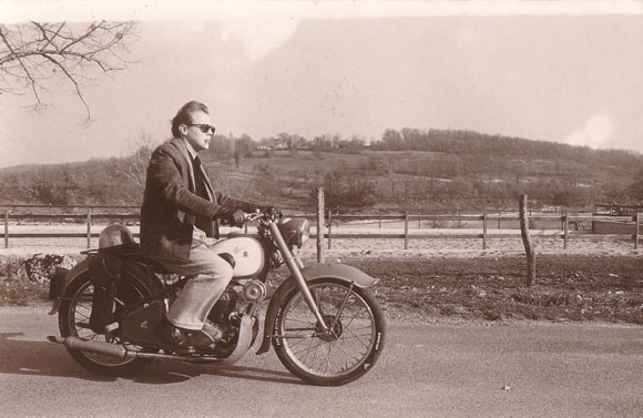 Christophe Loiron on his 1954 Peugeot, France, 1989.
