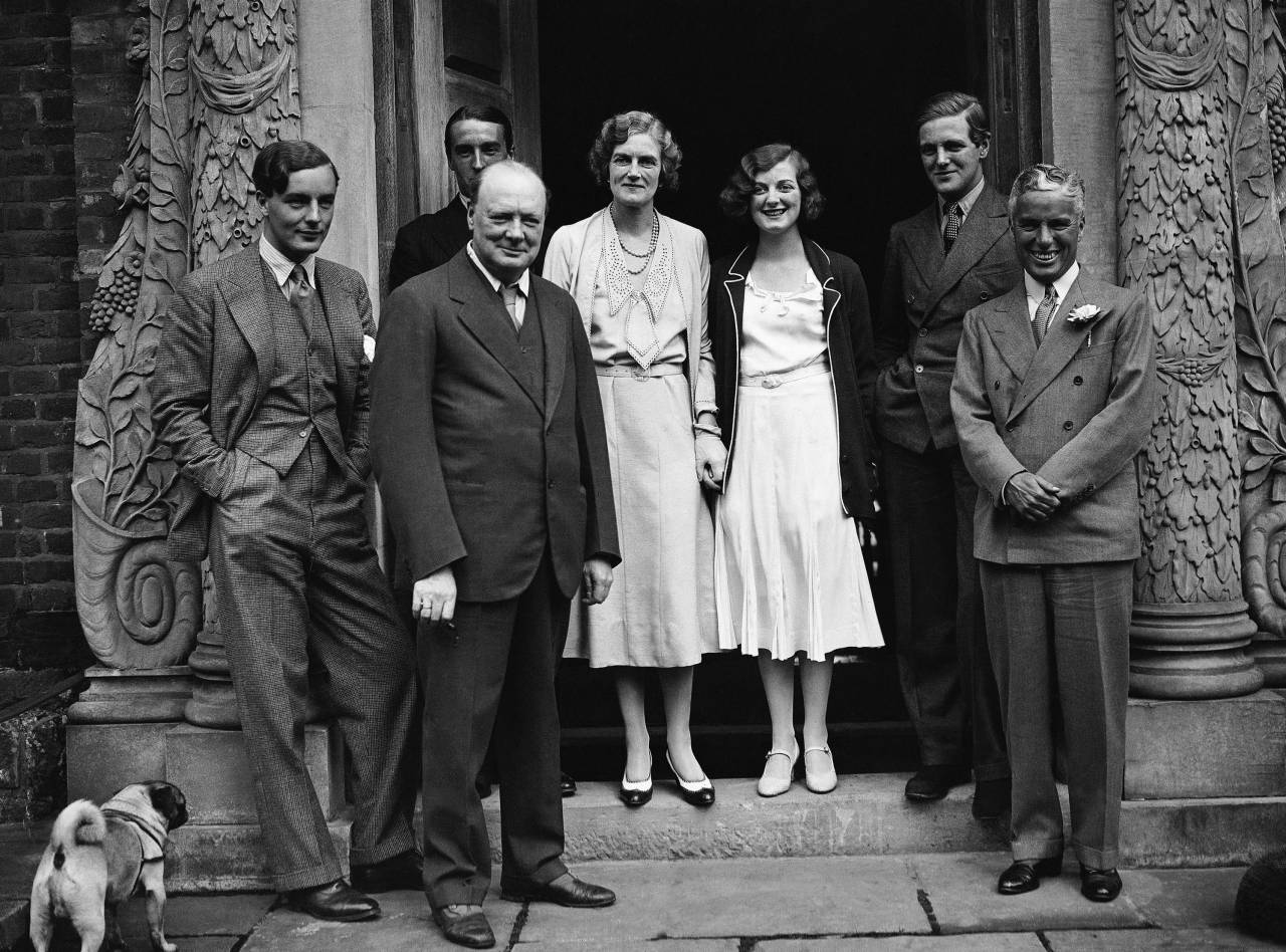 British actor Charlie Chaplin, right, met Winston Churchill, second left, and members of his family at Churchill's house in Westerham, Kent, England on England Churchill family and Charlie Chaplin, Westerham, Xen
