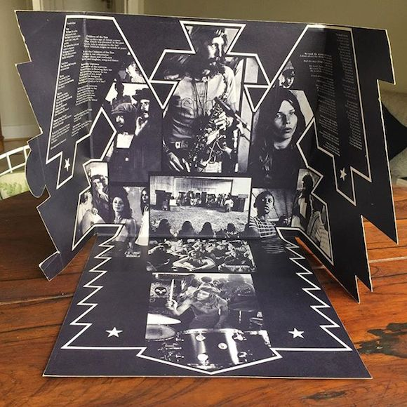 Hawkwind,Stevens' photograph as it appeared with others by Phil Franks, Nicky Hepworth and Malcolm Livingstone in the fold-out design