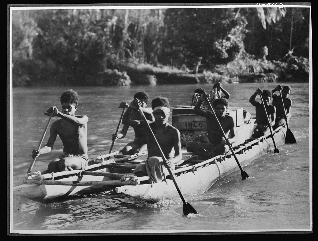 March 1943. Natives aid Allied drive in New Guinea jungles. Dense jungles, deep ravines and high mountain ranges make transport extremely difficult for the Allied troops in the New Guniea area. Outrigger supply services, manned by natives, are of invaluable aid in waging tropic warfare