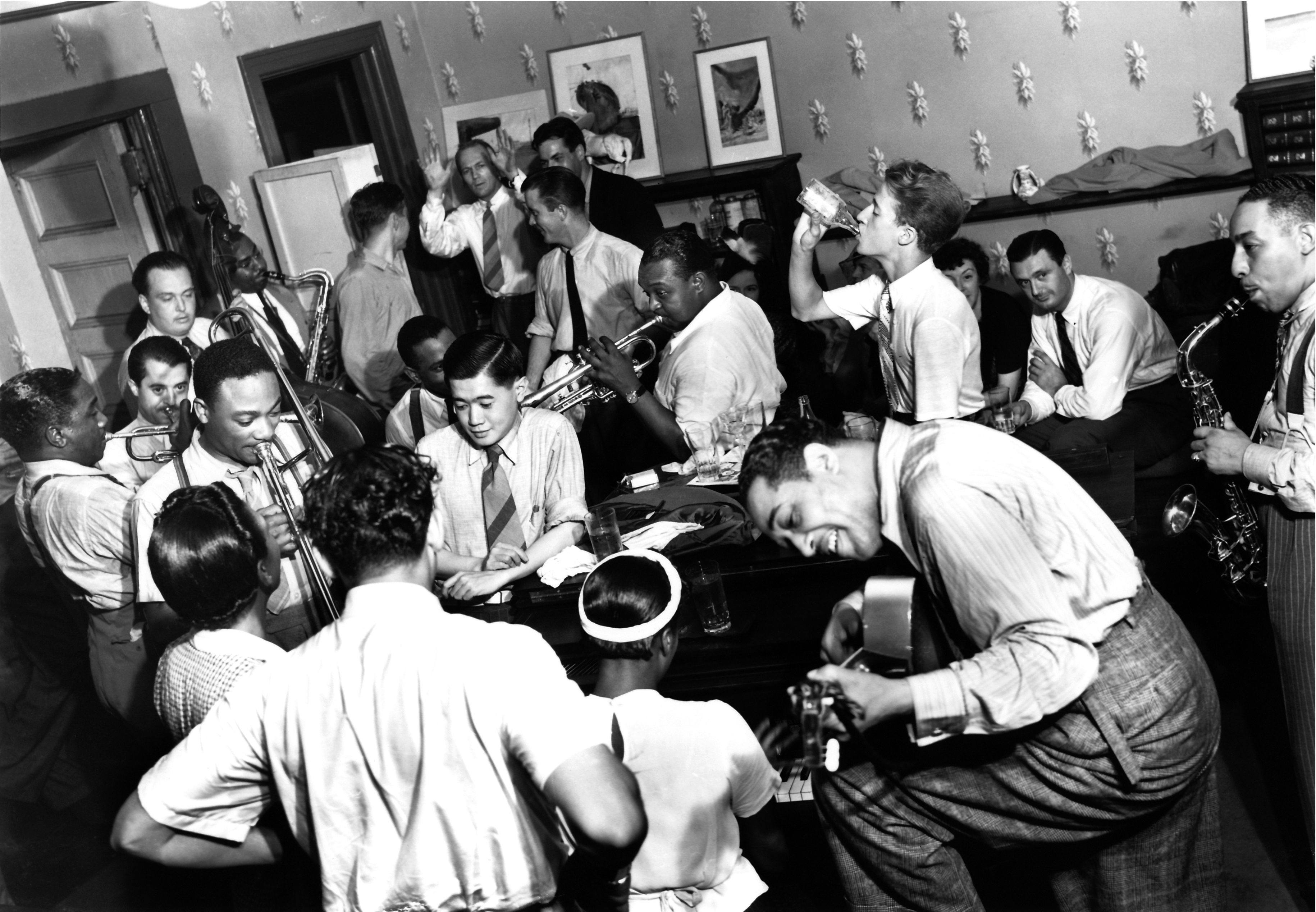 Cab Calloway, front row, back to camera with Ivie Anderson, Sister Rosetta Tharpe at piano; Duke Ellington on guitar, August 1939