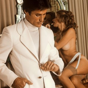 Fashion Studs: 1970s Macho Male Models & Their Rarely-Clothed Fawning Ladies