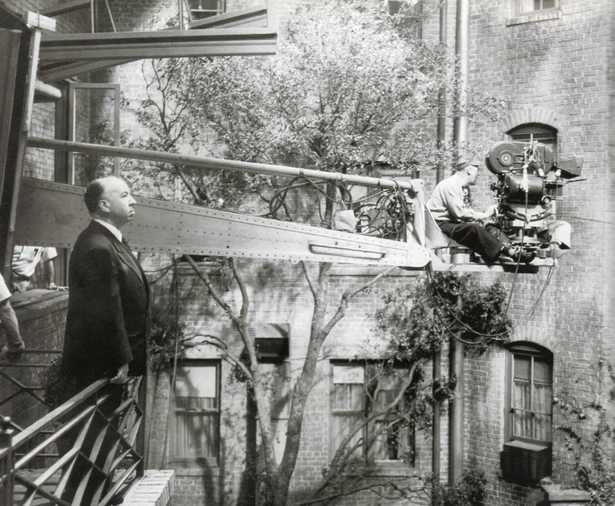 Hitchcock on the set of Rear Window, 1954