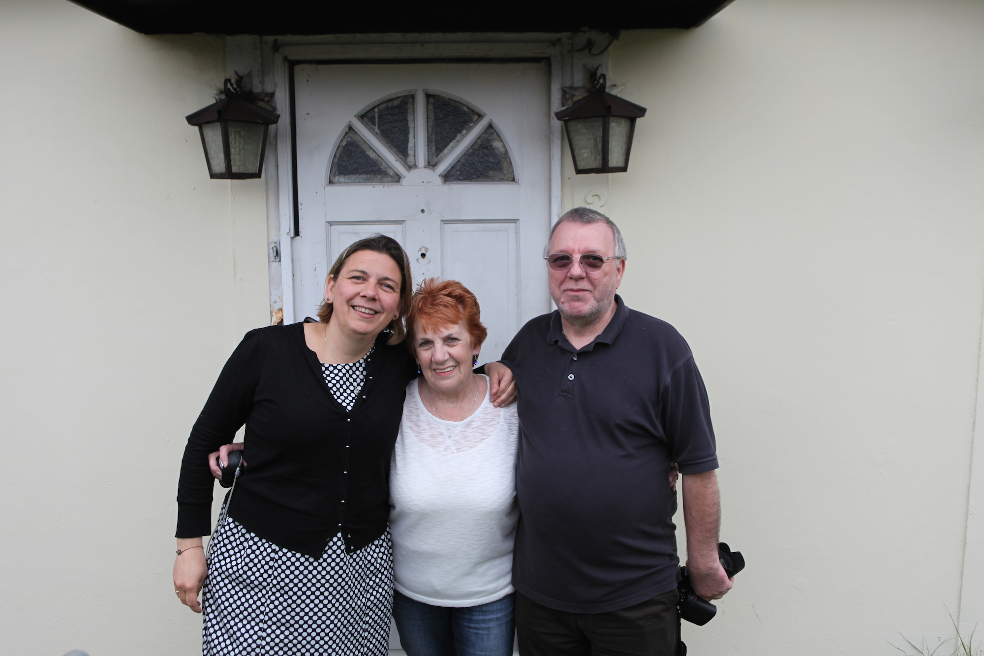 Elisabeth Blanchet, Rosemary Roffey and Alan Brine outside the prefab they grew up in on the Excalibur Estate, May 2014