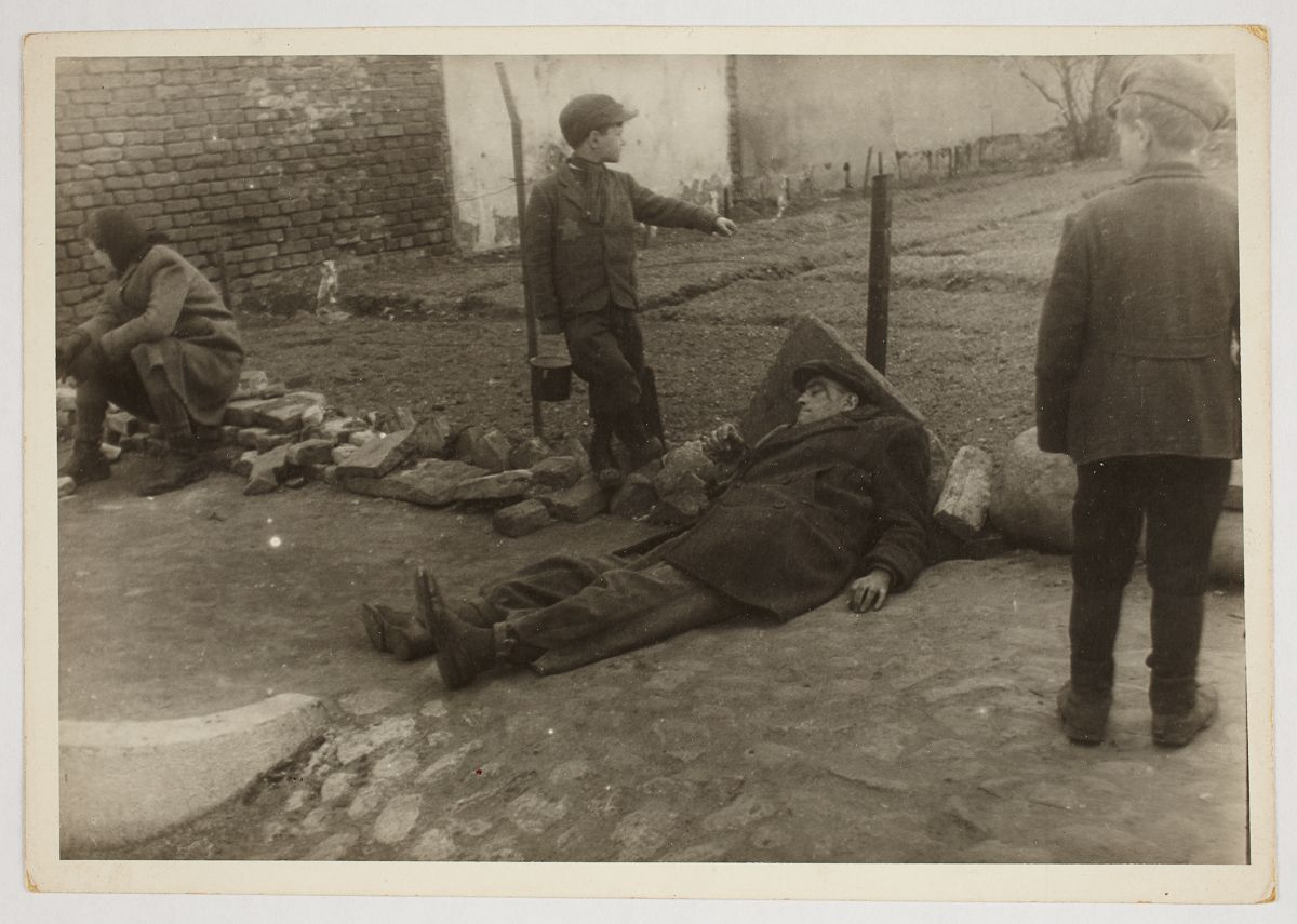 c. 1940-1944 A sick man on the ground.