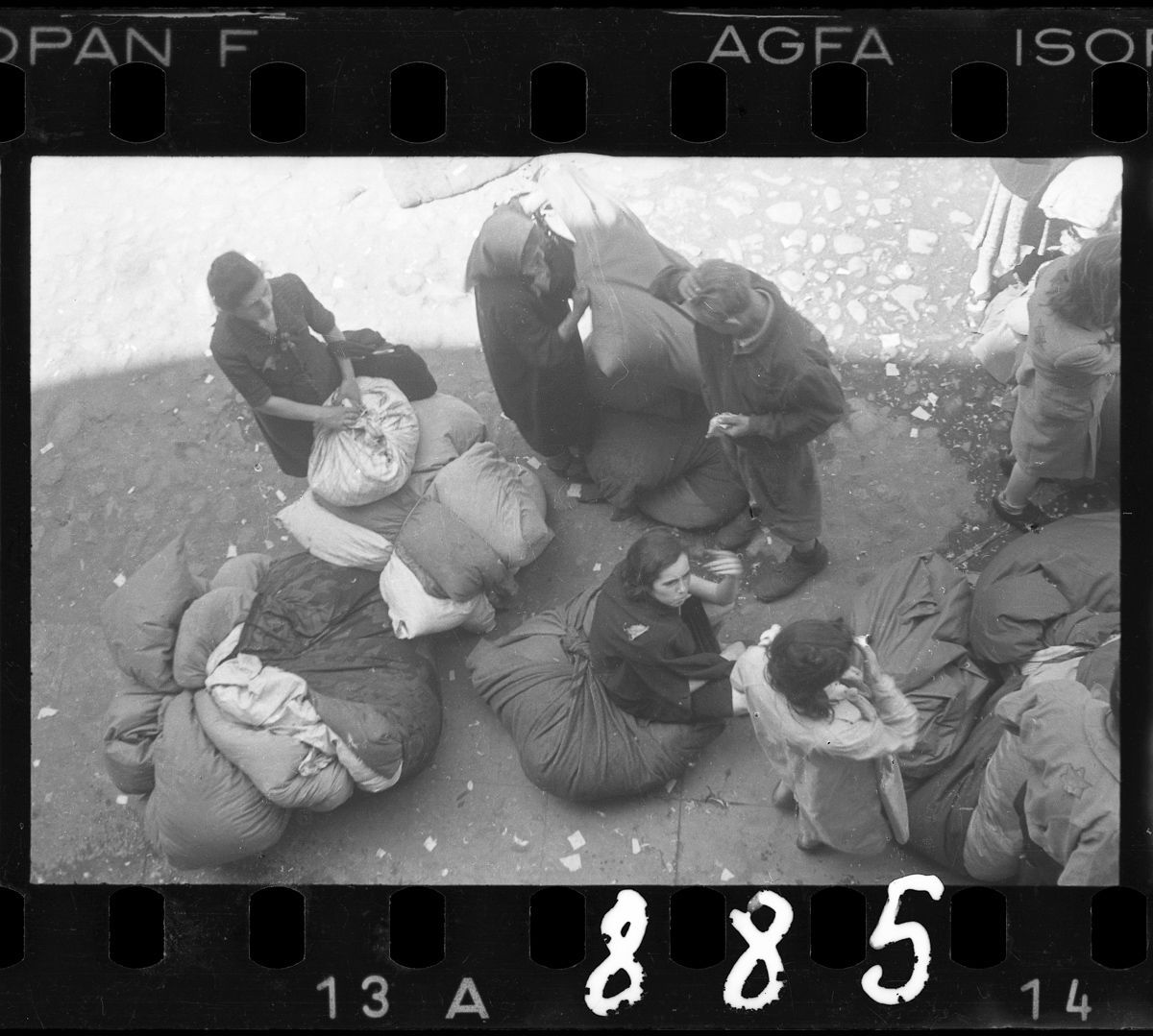 . 1940-1944 Residents sorting belongings left behind after deportation.