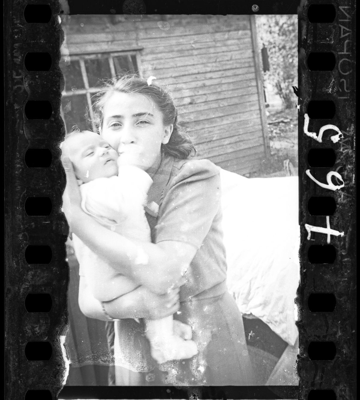c. 1940-1942 Woman with her child (Ghetto policemen's family).