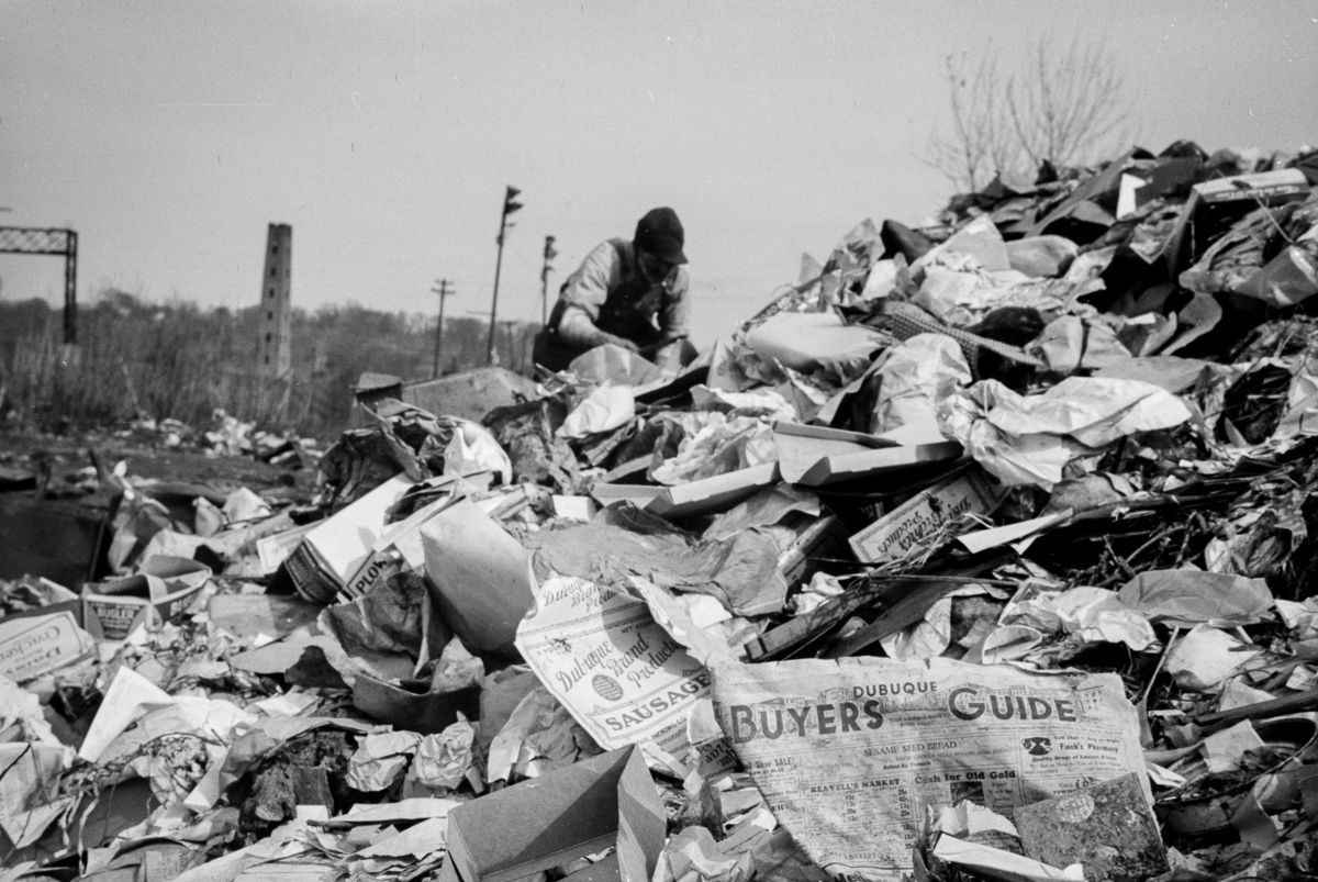 1940 A man scavenges in the Dubuque city dump.