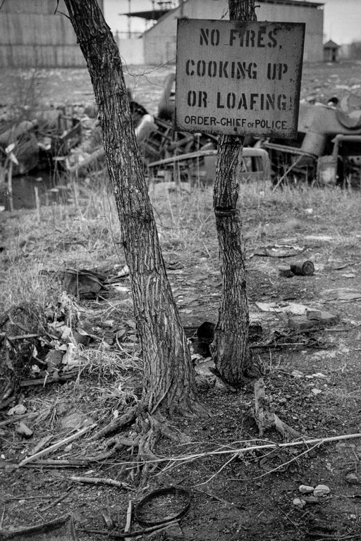 1940 A sign in the river bottoms shacktown in Dubuque.