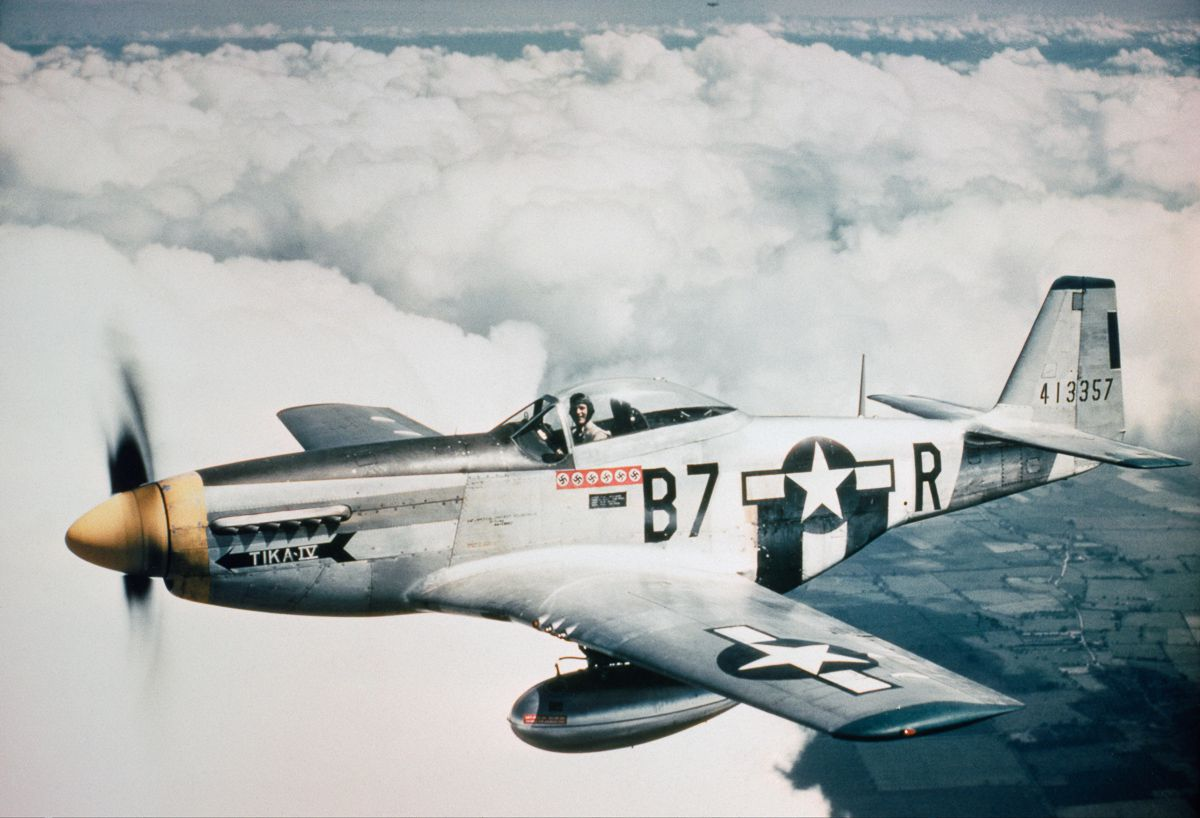 1944 Lieutenant Vernon R Richards of the 361st Fighter Group flies his P-51D Mustang, nicknamed 'Tika IV', during a bomber escort mission.