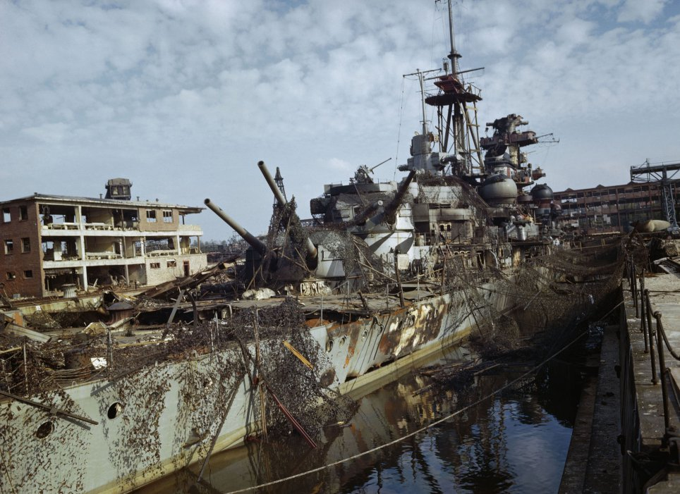 A German heavy cruiser abandoned in a dry dock at Kiel in May 1945