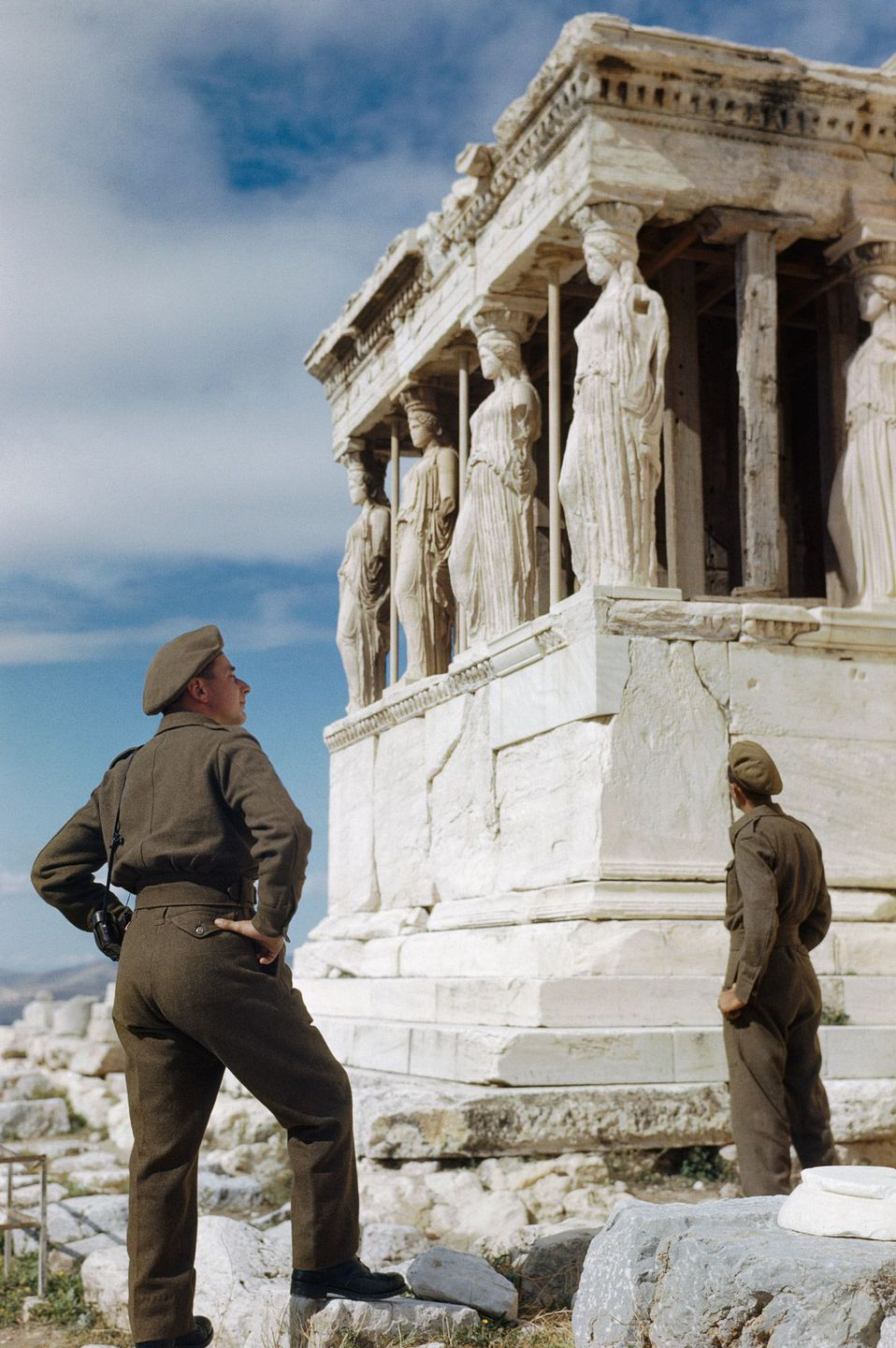 October 1944 British soldiers admire the Caryatids on the Acropolis while sightseeing in Athens.