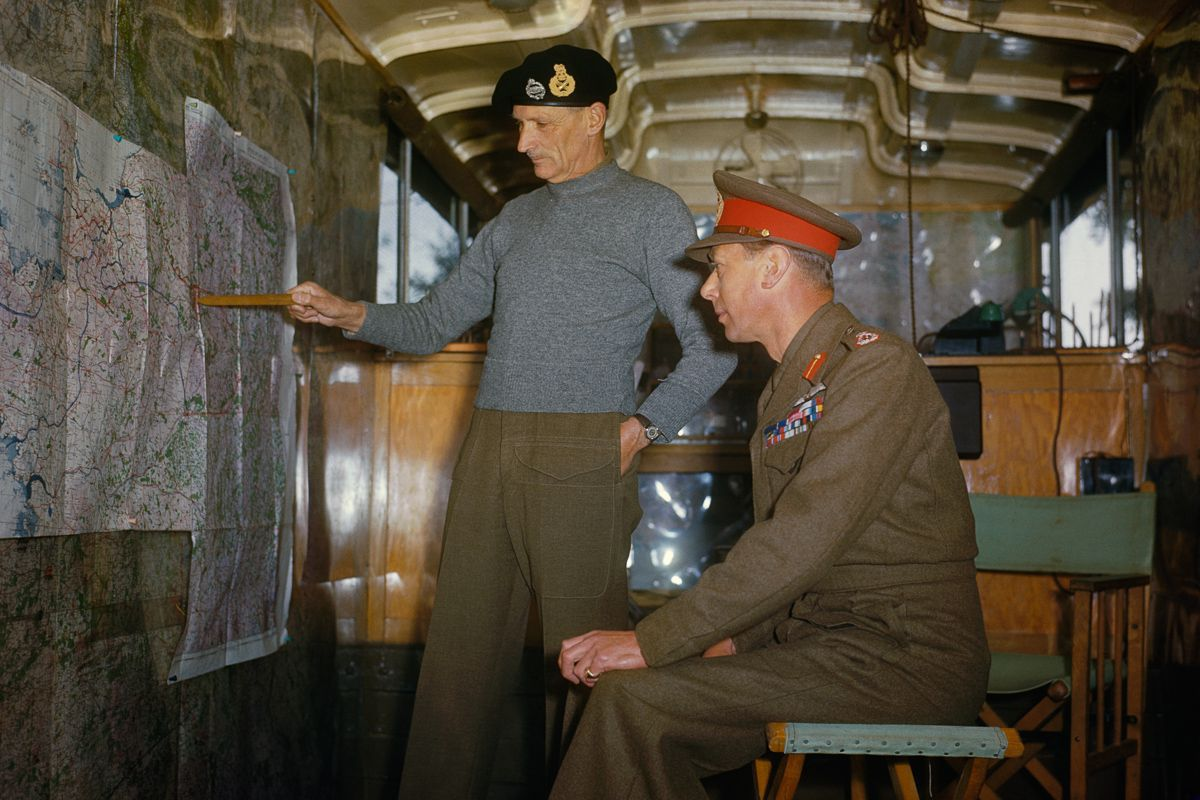 October 1944 Field Marshal Sir Bernard Montgomery explains Allied strategy to King George VI in his command caravan in Holland.