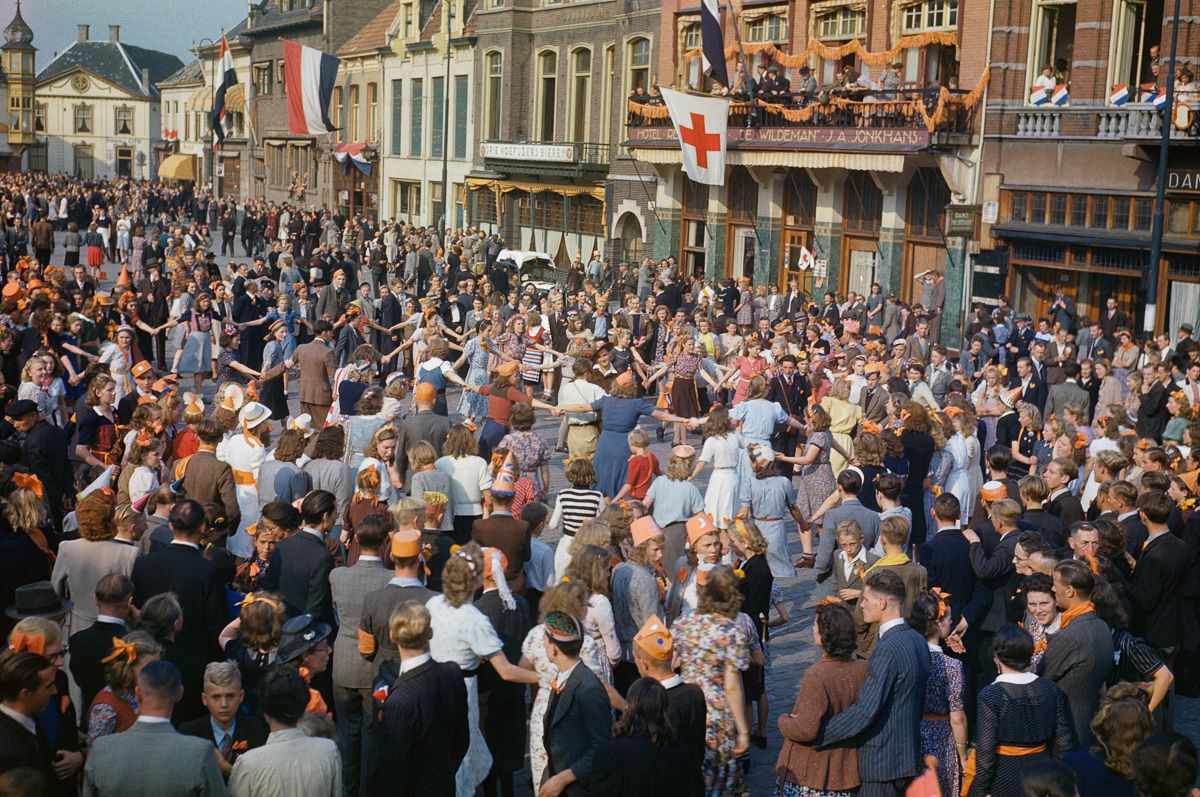 September 1944 Dutch civilians dance in the streets after the liberation of Eindhoven by Allied forces.