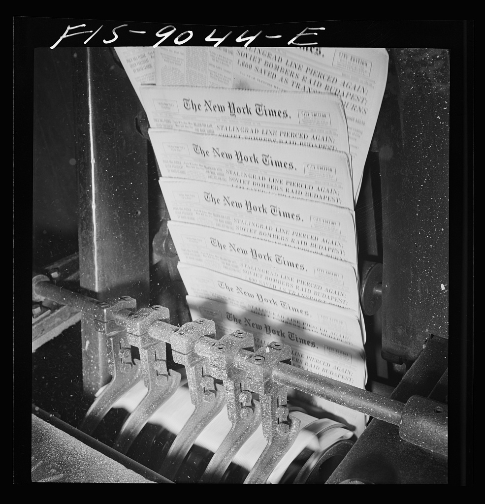 Pressroom of the New York Times department. Finished papers come out of cutting and folding machine on rapidly moving belt. Every fiftieth is automatically slated to facilitate counting