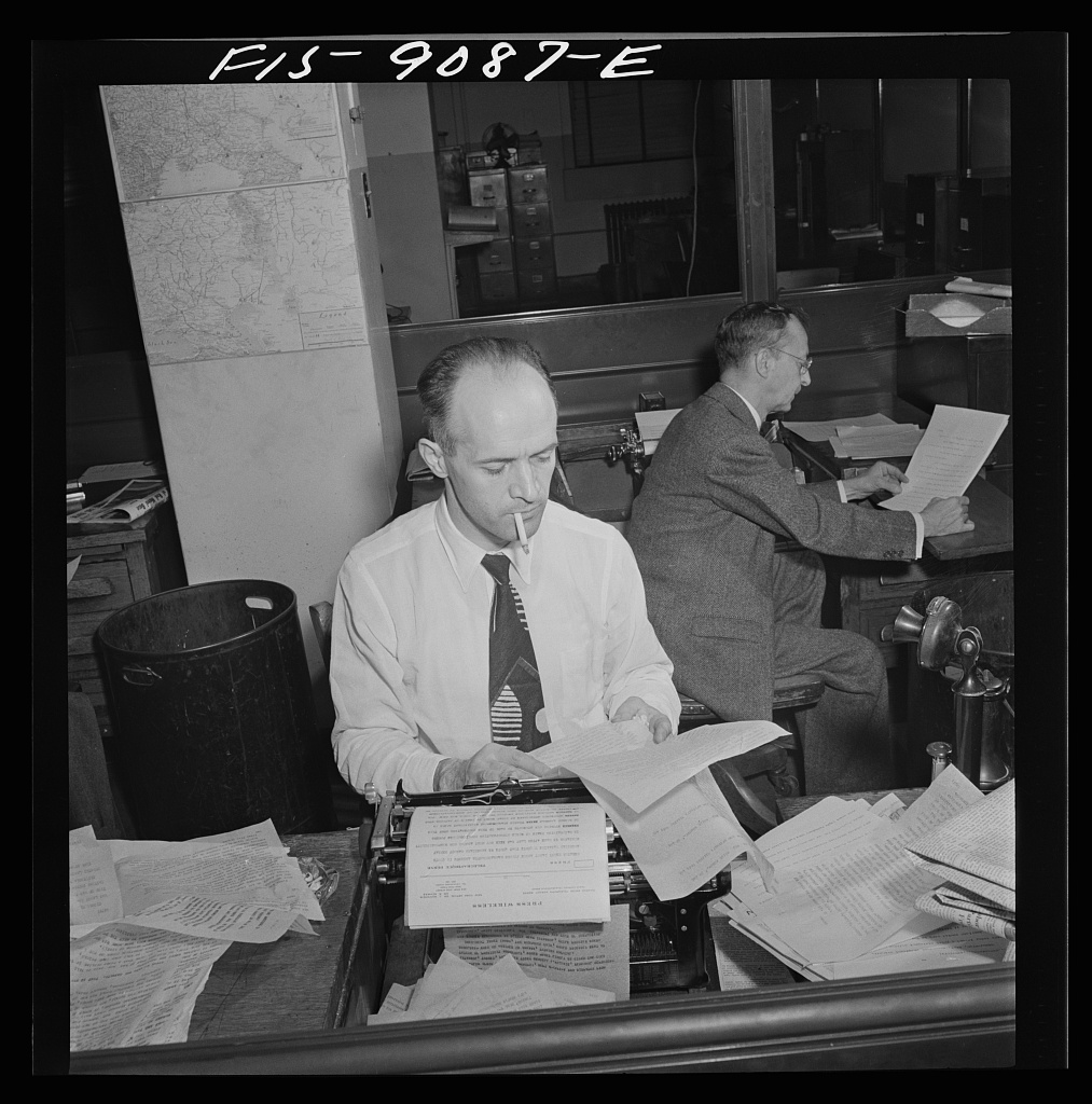 New York Times newspaper syndicate. Foreign newspapers and syndicates buy privilege of using Times news. The paper has so many correspondents all over the world, that often they scoop Associated Press and United Press. Swiss correspondent in foreground, Mexican in back