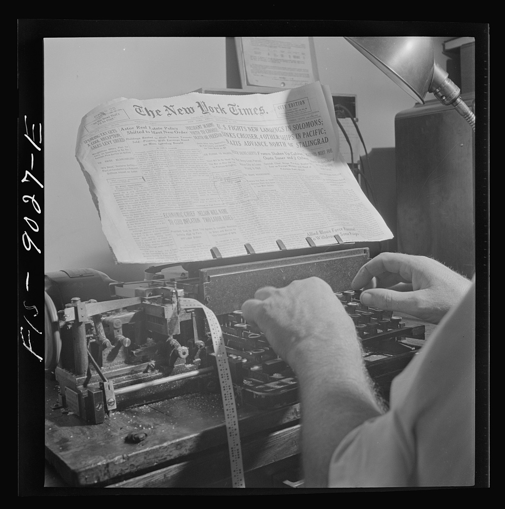 Radio room of the New York Times newspaper. Times news passed by naval censor (see stamps on paper) is sent out twice daily by the Times' own short wave radio transmitter in international Morse code, and received by ships