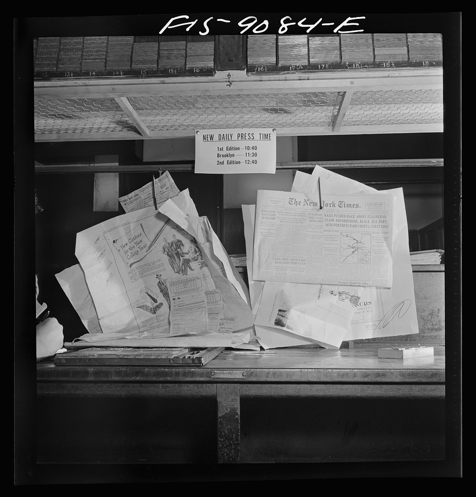 Composing room of the New York Times newspaper. Proofs on wall in the advertising end of the room