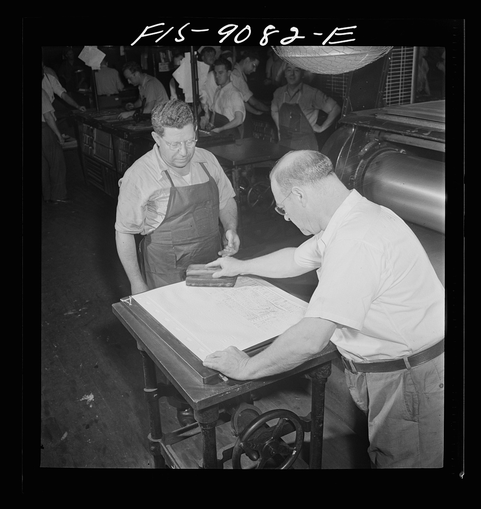 "Composing room of the New York Times newspaper. Paper mat is made in ""rock crusher"" and inked for visibility"