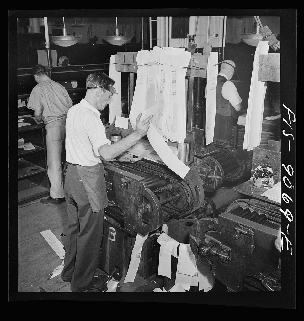 Composing room of the New York Times newspaper. Proof press turns out proofs for distribution to make-up editors for correction
