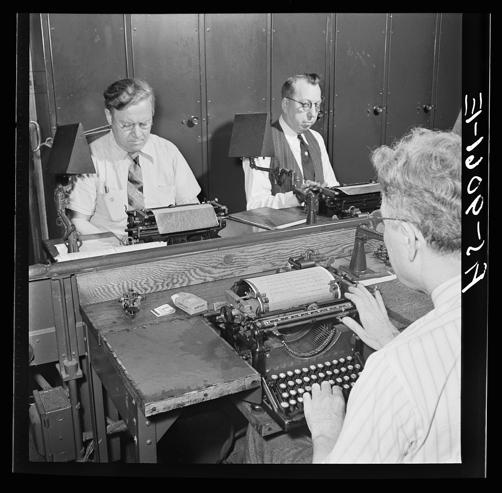 Wire room of the New York Times newspaper. Telegraphers receive and record messages received by Western Union and Postal Telegraph from Times correspondents all over the United States ...
