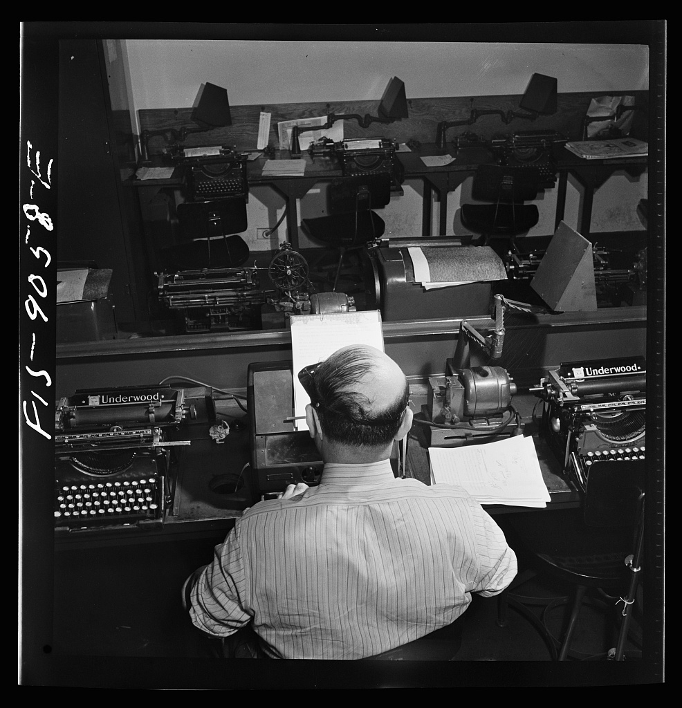 Wire room of the New York Times newspaper. Telegrapher receives dispatch by Western Union from Times correspondent somewhere in the United States