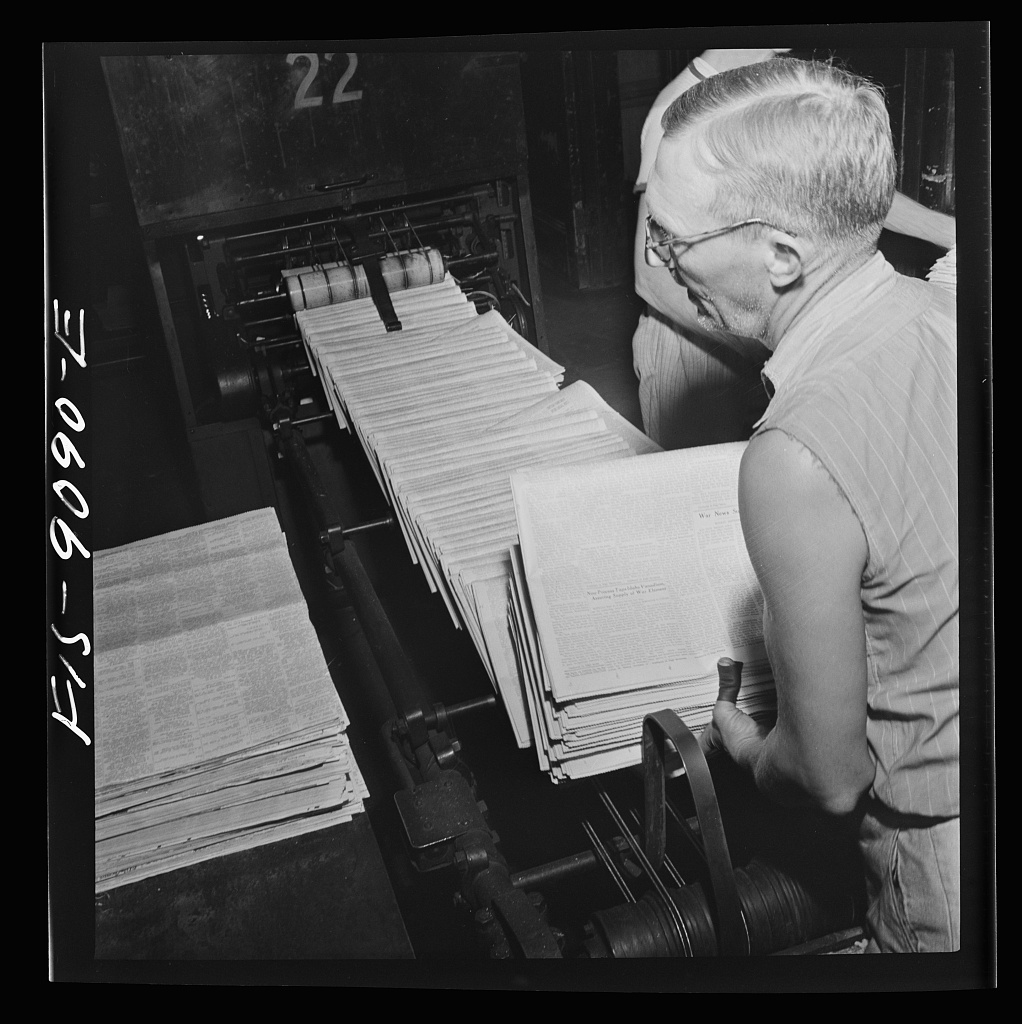 Mailroom of the New York Times newspaper. Papers come from the pressroom on a conveyor