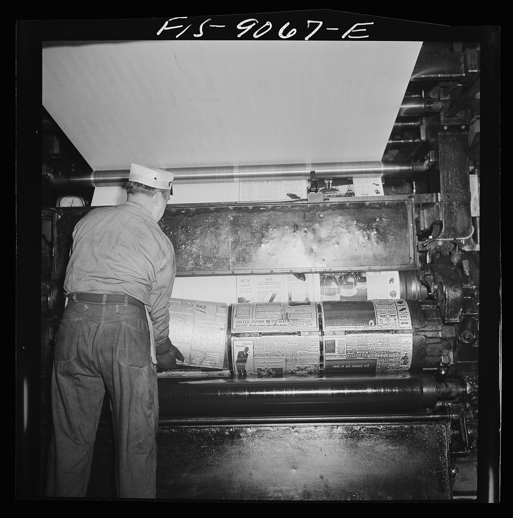 Pressroom of the New York Times newspaper. Placing plates on cylinder of press