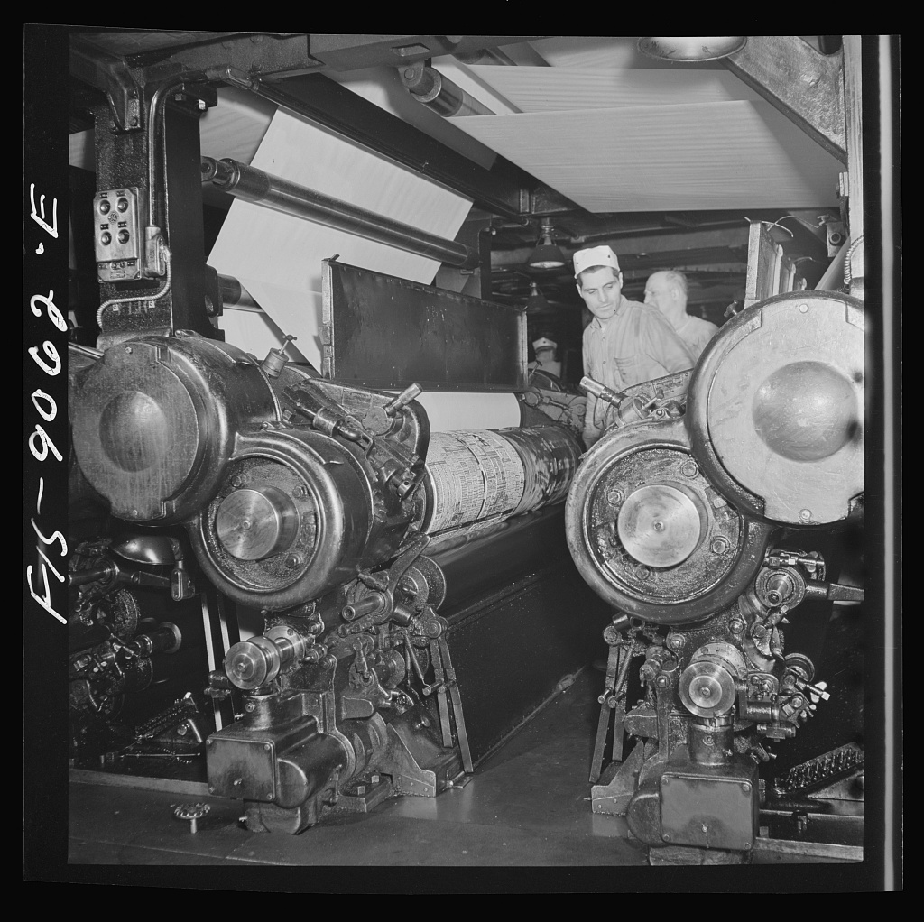 Pressroom of the New York Times newspaper. Putting plates into presses before they start rolling