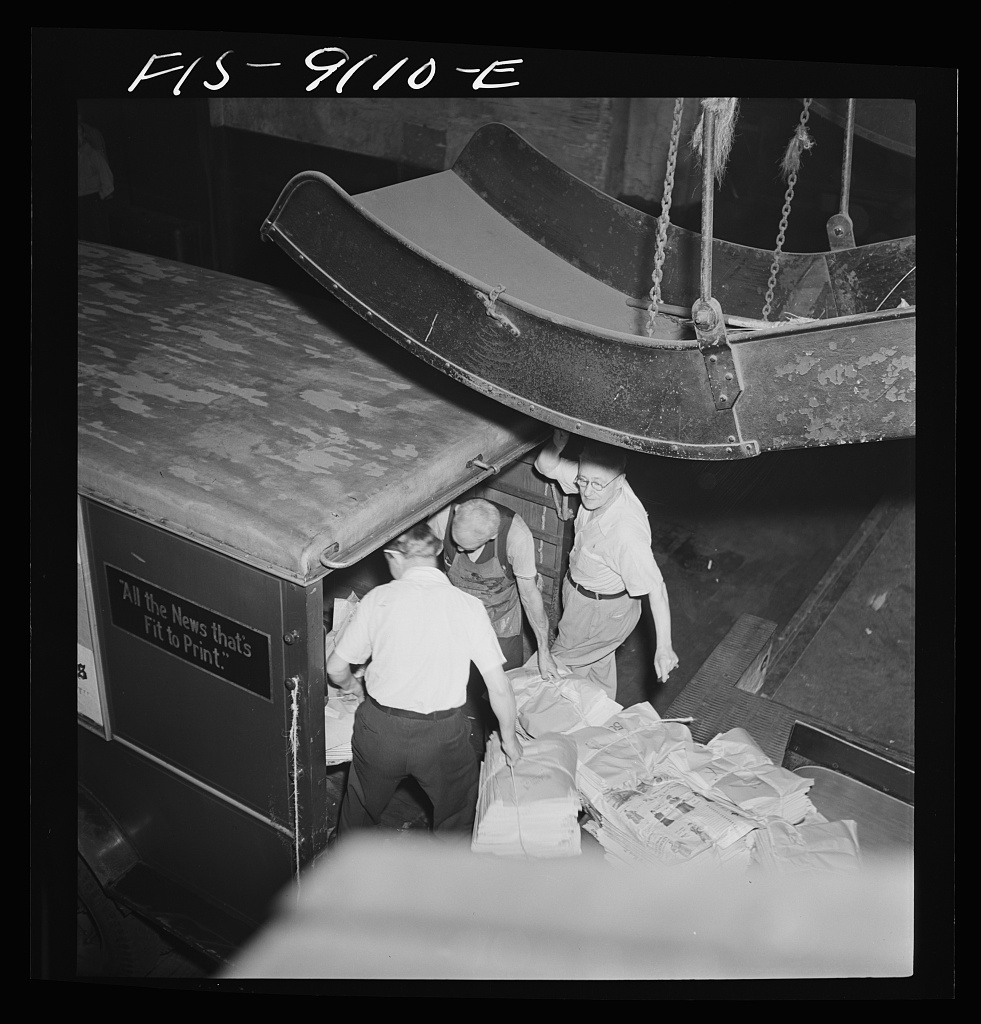 New York Times newspapers being loaded on trucks from mailroom