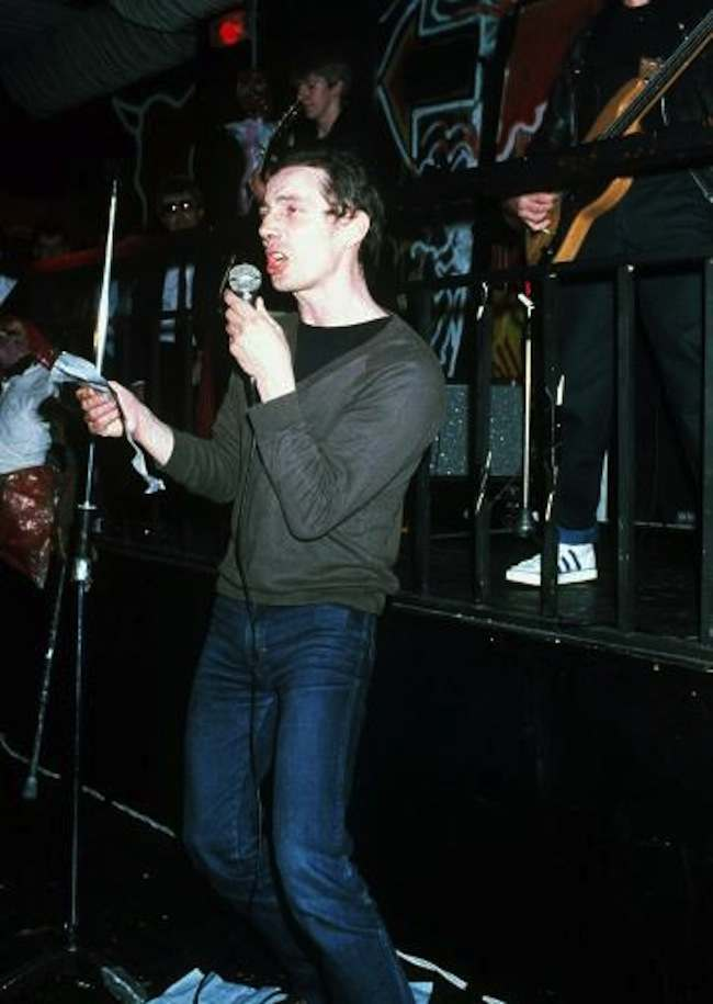 "PA NEWS PHOTO AN UNDATED FILE OF BUCKINGHAM PALACE INTRUDER MICHAEL FAGAN MAKING HIS DEBUT AS A SINGER, WITH A THREE MINUTE SPOT AT THE ""SON OF BATCAVE"" CLUB IN LONDON'S LEICESTER SQUARE. HE SANG A PUNK VERSION OF THE NATIONAL ANTHEM"