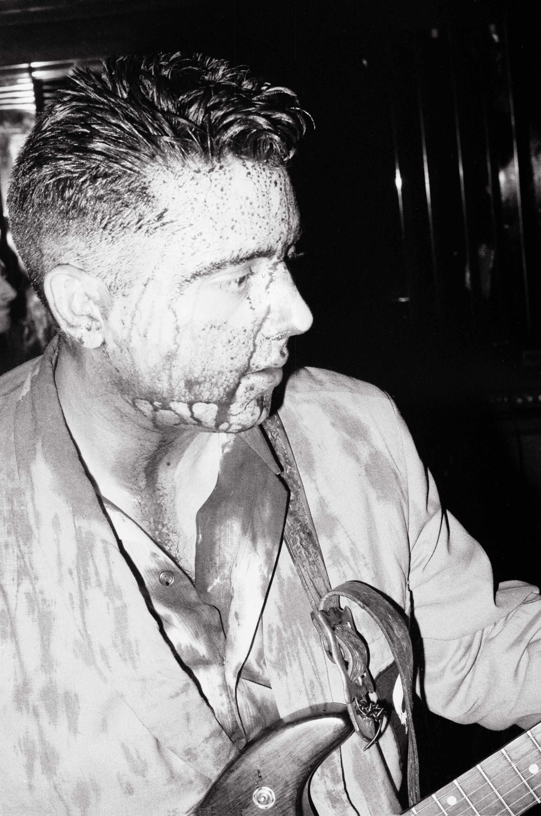 Covered in chicken blood, lead singer P.Paul Fenech of the psychobilly band The Meteors at the Batcave in Soho 1982.
