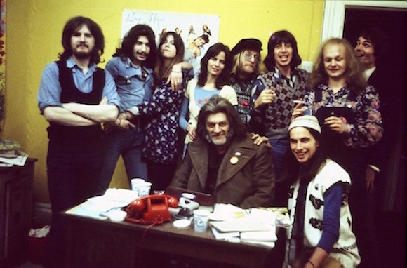 Oz staff, summer 1972, clockwise around Eric The Tramp, from left: Reviews editor Dick Pountain, ad salesman Howard Tait, unidentified, contributor/co-founder Louise Ferrier, editors Jim Anderson and Richard Neville, art director Richard Adams, typesetter Geoff Marsh, designer David Wills. Photo: Joe Stevens. No reproduction without permission