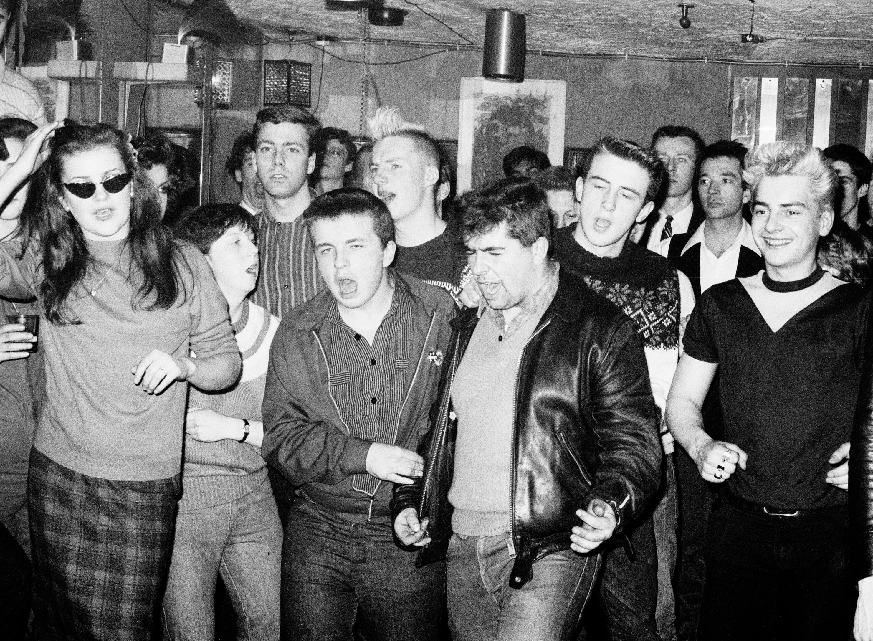 Fans listening to the psychobilly band The Meteors at the Batcave in Soho 1982.