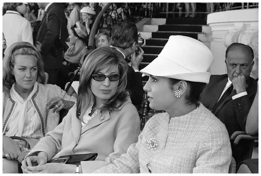 Italian actress Monica Vitti (left) and Rossana Schiaffino attend Rome's Derby Horse Race at the Capannelle track in Rome on May 7, 1964. (AP Photo/Giulio Broglio)