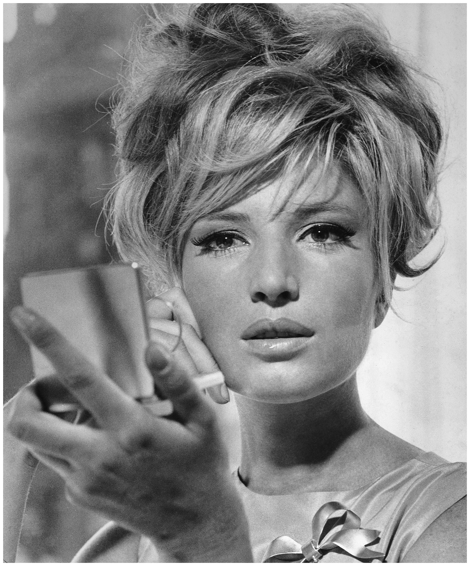 Monica Vitti looking at herself in the mirror in a scene from the film 'Modesty Blaise', 1966. Director Joseph Losey. 1966