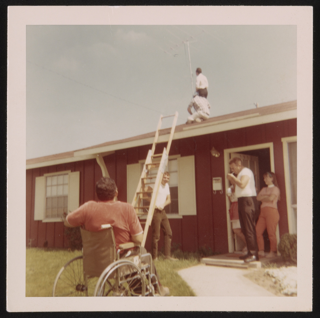 Our next door neighbors help us put up leads to antenna for T.V 1968